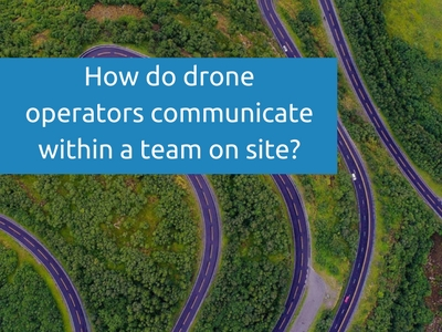 How do drone operators communicate within a team on site_